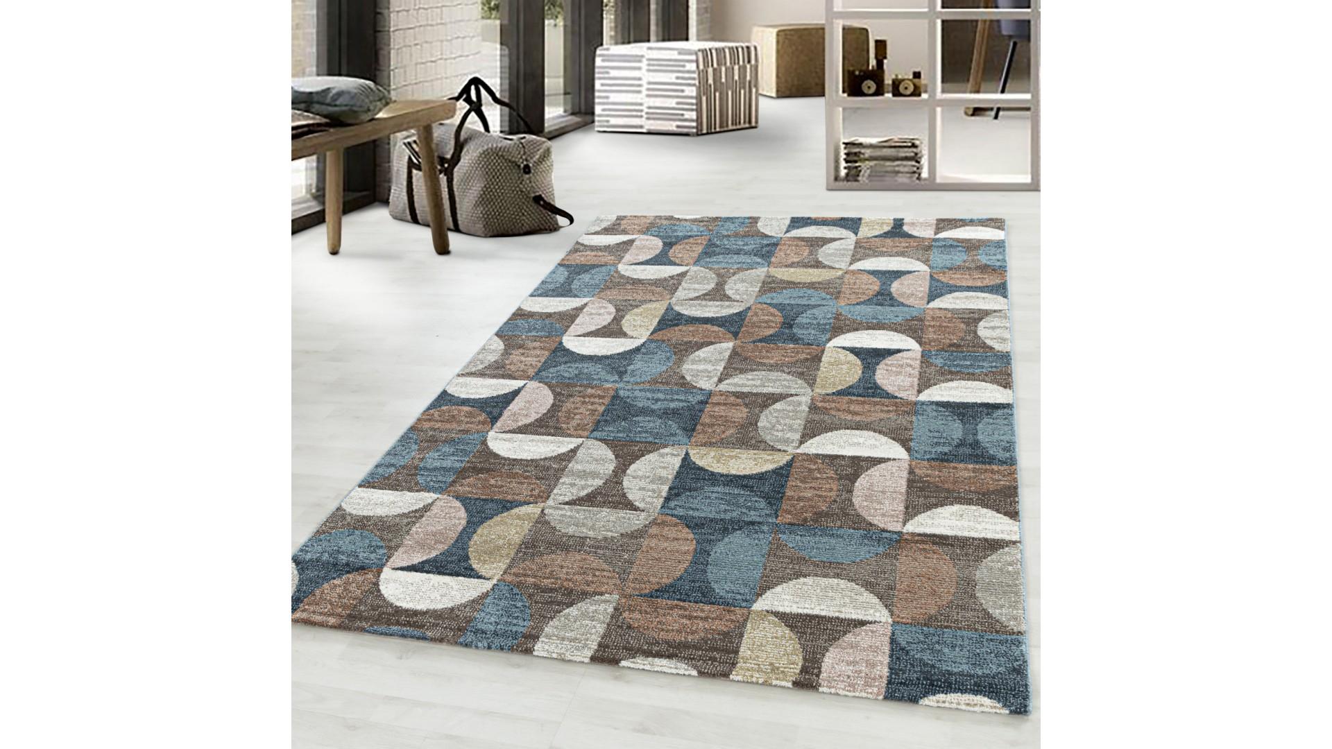 Nowoczesny dywan do salonu i sypialni o modnym geometrycznym wzorze.