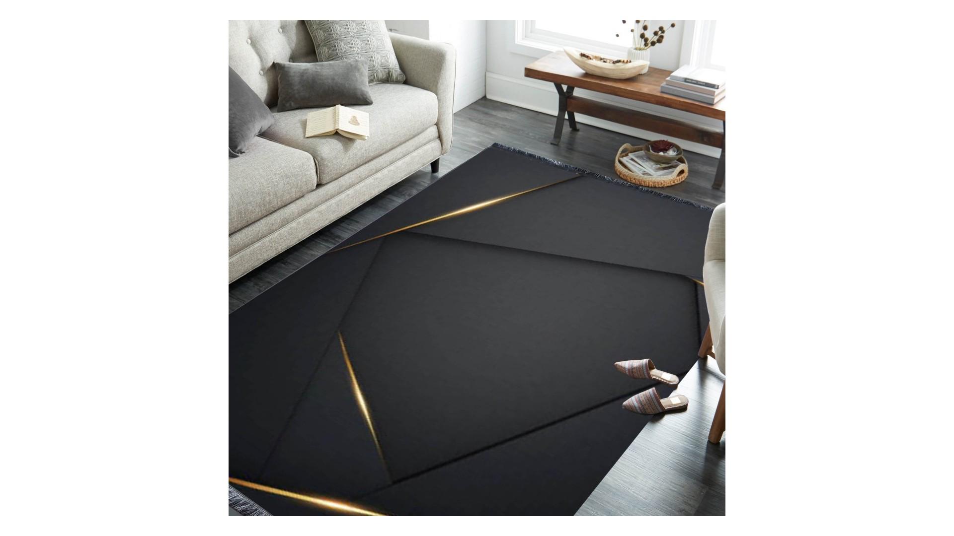 Elegancki dywan FLASH z kolekcji Horeca zachwyca głęboką czernią i złotymi refleksami.