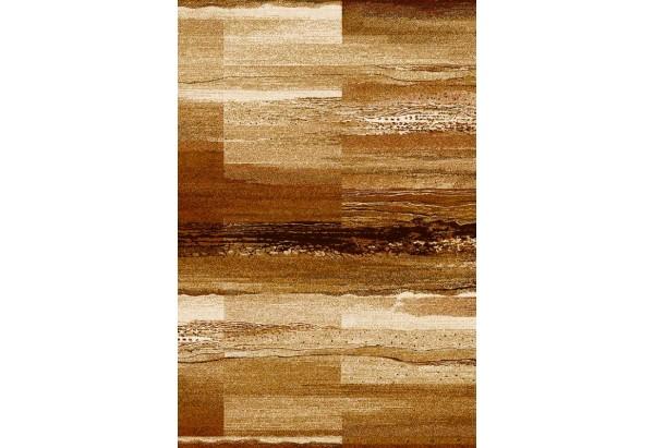 Niesamowity dywan o cynamonowych barwach.