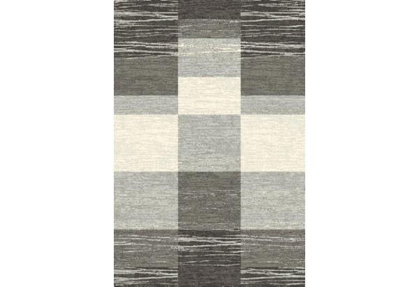 Nowoczesny dywan w kolorze szarości.