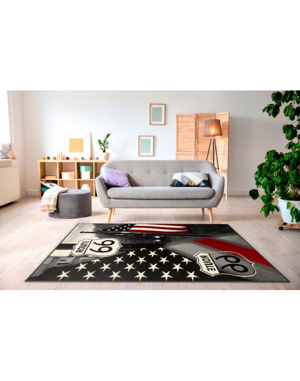 Nowoczesny dywan do salonu AMERICAN RT66 Black CITY doskonale zmieni aranżacje Twojego wnętrza.