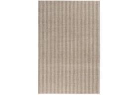 Dywan posiada modne paskowe wzory dywanu.