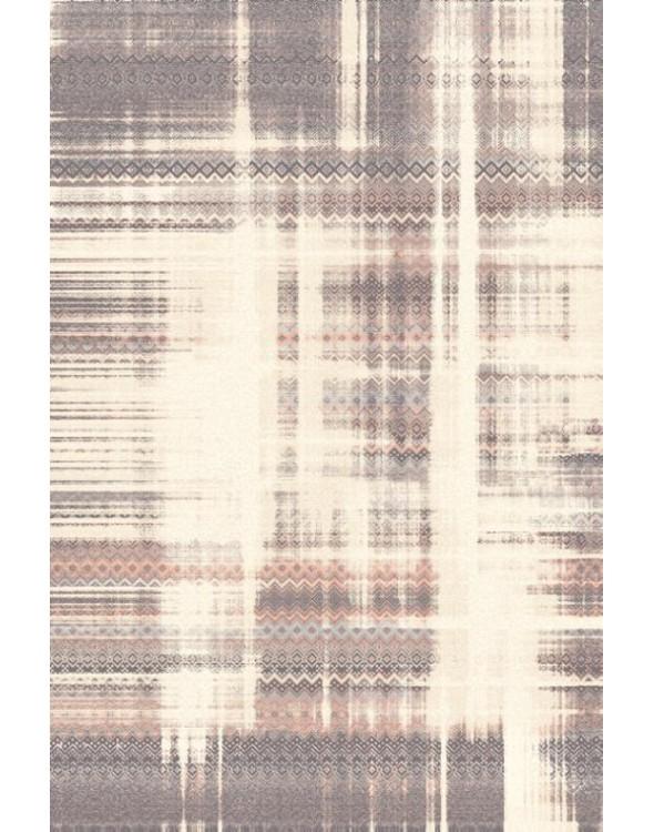 Nowoczesny dywan do salonu o mazanych jasnych wzorach.
