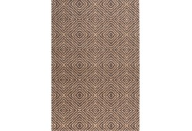 Piękny wełniany dywan w geometryczne wzory.