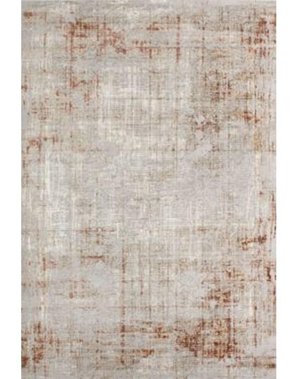 Elegancki dywan z modnymi refleksjami brązu.