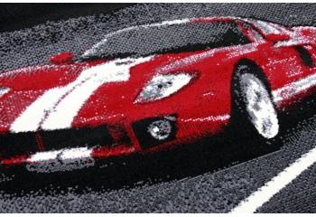 Motyw rozpędzonego sportowego auta FERRARI.