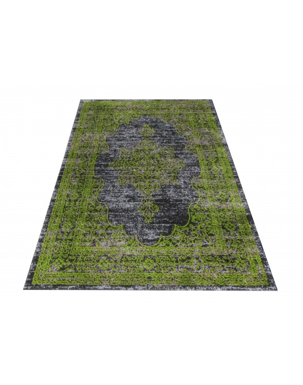 Efektowny dywan zielony we wzór.