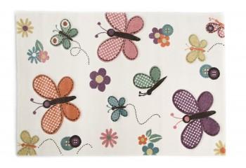 Kolorowe motylki na dywanie.